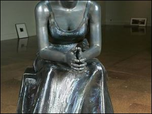 Jamie Goode's <i>Contemplation</i> shows a seated woman.