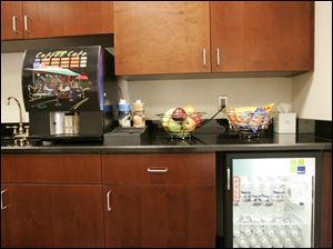 Complimentary fruit, bottled water, and a choice of coffees are part of the service at the Sylvania Township Lexus dealership.