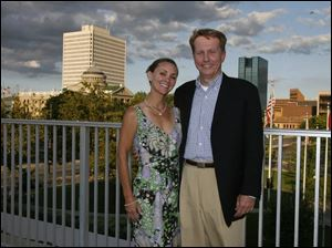 ROOF PROOF: On a perfect midsummer night, Sandra and Greg Chesnutt have a breathtaking view of the downtown from the Main Branch library.