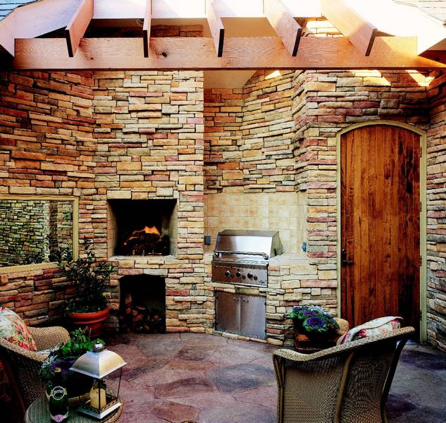 Stone Fireplace Next To The Outdoor Kitchen And A Lovely: OC To Buy Producer Of Faux Stone In Europe