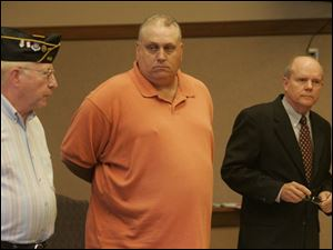 Post 441 member Tom German, left, speaks to the court before the sentencing of Roger Glasgow, who stole post funds.