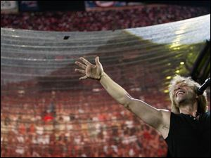 Jon Bon Jovi performs at Giants Stadium in East Rutherford, N.J., on July 18. Bon Jovi sold out three nights at the 80,000-capacity behemoth.