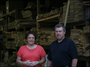 James Eloff plans to fund Kayo Lumber's pension plan sufficiently to cover office manager Judy Nolan, left, and one other employee.