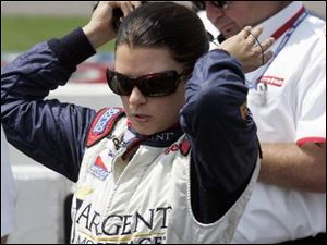 Danica Patrick tidies up after qualifying 11th for today's race. Next season, she'll be qualifying in Michigan as a member of Andretti Green Racing.