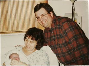 Michael Luebrecht, with wife Amy after Joel's birth in 2004, was sentenced to at least 25 years.
