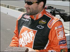 Tony Stewart holds one of the original bricks from the Indianapolis Motor Speedway that was presented to him yesterday. The Indiana native went to the Brickyard as a youngster and dreamed of competing there.