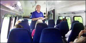 Steve McConaughy leads an impromptu Bible study after the bus his group was taking to the Creation Museum broke down. The 21 on board eventually made it to the museum.