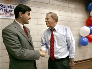 Toledo City Council candidate Joe McNamara, left, greets Democratic gubernatorial candidate Ted Strickland during a stop at the UAW hall yesterday.