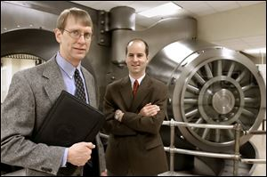 A study by Paul Bauer, left, and Mark Schweitzer of the Cleveland Federal Reserve Bank concluded that patents per-capita were the source of Ohio's wealth. They cited a decrease in patents as the cause of the state's economic slump.