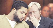 Former-Ohio-State-football-star-Maurice-Clarett-talks-with-attorney-Nick-Mango-before-pleading-guilty-to-aggravated-robbery-and-carrying-a-concealed-weapon-in-Columbus-Ohio