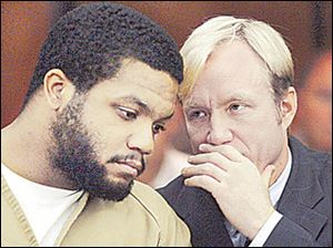 Ex-OSU football star Maurice Clarett listens to attorney Nick Mango before pleading guilty in court.