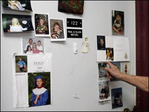 The door of Ellen Wetzel s apartment at Crestview is covered with photos that she will move to her new home. The retired nurse has high praise for the staff at the complex for seniors.