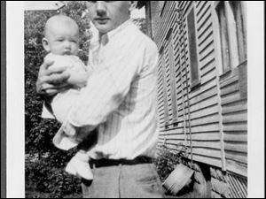 Jack Kennedy, Sr., cradles his son, Jack Kennedy, Jr. The younger Mr. Kennedy was just 4 years old when his father was killed.