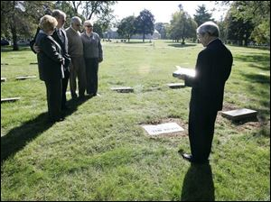 Bonnie and Ken Dickson, left, and Jack and Barbara Kennedy listen as the Rev. Robert Wilhelm
