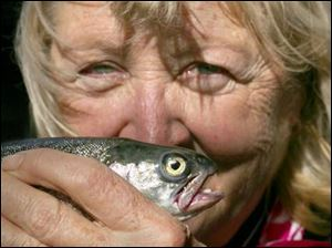 Recovering breast cancer patient Nancy May of Grand Rapids proudly shows off her trout.