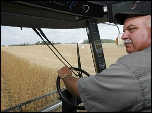 John 'Cash' Young harvests soybeans on his farm near Bowling Green in Wood County.