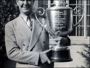 Byron Nelson displays his 1940 PGA trophy. He told The Blade in 2001 he considered Inverness his home course.