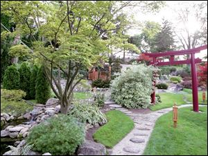 The renovated area is serene with bridges, lanterns, a torii (a large, rectangular gate), and a refl ecting pool.