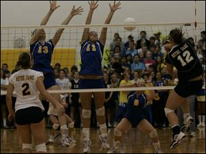 St. Ursula's Ashley Heyman (13) and Hannah Boggus (11) try to block a shot by Notre Dame's Jessica Batanian (12).