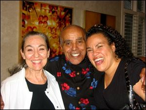 Toledo jazz great Jon Hendricks is flanked by his wife, Judith, left, and daughter, Aria, at his birthday party.