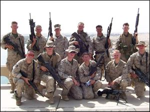 All but one of the members of the 1st squad, 3rd platoon, Lima Company pictured here