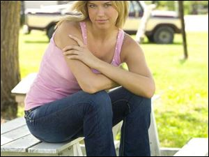 Adrianne Palicki in the new NBC series <i>Friday Night Lights</i>. When Palicki began landing television roles, her mother, Nancy, turned to Kathy Holmes (Katie's mother) for advice.