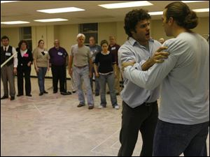 Lee Gregory, left, and Eric Fennell rehearse a scene of Toledo Opera's production of <i>Romeo and Juliet</i>.