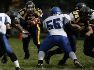 Whitmer junior quarterback Donnie Dottei has thrown for 704 yards, completing 47 of 90 passes, and has rushed for 331 yards.