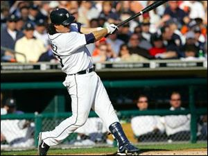 Magglio Ordonez slugs a solo home run in a three-run Tigers' second inning. He finished with two RBIs and three runs.