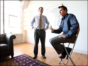 Joe Kidd's longtime friend, Jon Stainbrook, left, visits with Mr. Kidd at Mr. Kidd's Detroit loft. Mr. Kidd's hiring of Mr. Stainbrook to work with the board of elections once enraged Lucas County Auditor Larry Kaczala, who was challenged by Mr. Stainbrook in a primary race.