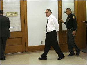 Danny Anaya leaves the courtroom at the Lucas County Courthouse, where his murder trial began yesterday.