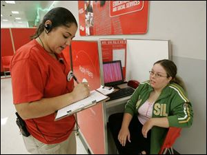 Lenesa Dunahoo, a supervisor at a Target on Monroe Street, asks job applicant Amanda