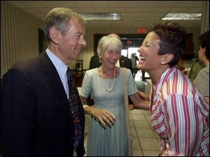 U.S. Sen. George Voinovich (R., Ohio) and his wife, Janet, amuse Bernadette Noe before the roast for her husband.