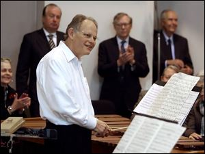 Robert Bell is applauded during his informal percussion recital.