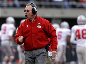 Ohio State coach Jim Tressel was pumped in the first half when his team scored all 17 of its points against Illinois.