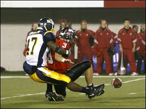 Toledo linebacker Steven Morrison sacks Northern Illinois quarterback Phil Horvath, causing a fumble which the Rockets