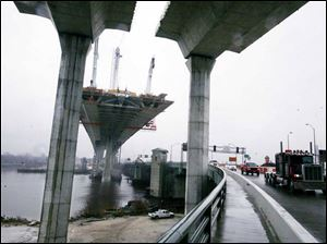 ODOT's current schedule calls for the Veterans' Glass City Skyway over the Maumee River to open to traffic by mid-spring.