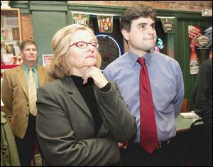 Joe McNamara, candidate for Toledo City Council, waits for election results at Wesley s Bar & Grill with supporters and his campaign co-chairmen, Keith Wilkowski, left, and Judy Stone.