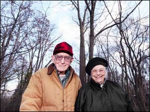 Gerald and June Meyers are dwarfed by the whopper of a locust tree behind them. It is 103 feet tall and measures 155 inches around. This is the third time they've won in the last four years.