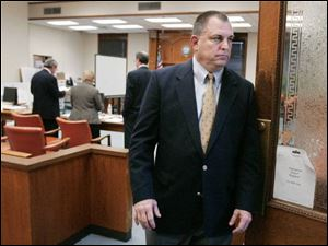 Tom Noe leaves the courtroom after the jury begins weighing evidence from his trial on charges of stealing millions of dollars from the Ohio Bureau of Workers' Compensation.