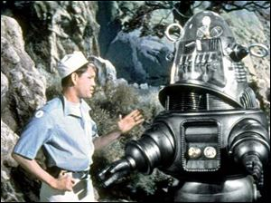 Robbie the Robot, shown in Forbidden Planet, is an endearing symbol of science fiction.
