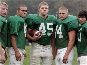 Oak Harbor running backs, from left, Andy Warns, Aaron McCune, Jake Lipstraw, Matt Bloomer and Tom Baker have helped the Rockets compile 3,155 yards on the ground.