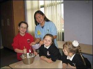 Sandra Moon works with children at the Afterschools Club at a Presbyterian church in North Belfast, Ireland. Ms. Moon will discuss her volunteer work in a talk tomorrow at Glendale Presbyterian Church in Toledo.