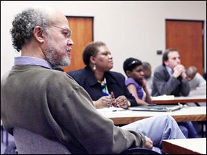Abdul Alkalimat, left, participates in a meeting at the Student Union on the future of Africana studies at UT.
