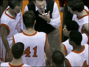 Bowling Green State University coach Dan Dakich tries to fire up the troops yesterday in Anderson Arena, but his Falcons hit just 32 percent from the field and lost to Central Arkansas. BGSU's record is now 4-3.