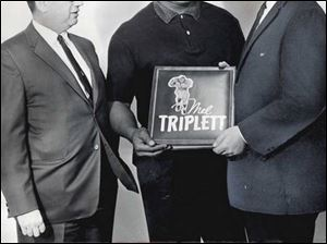 Rothman, left, is seen here with former UT football star Mel Triplett, center, and former Blade artist Charles Beyer in 1964.