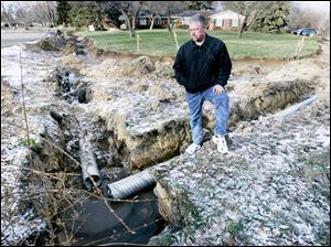 Drainage ditches like the one viewed by Mike Malone are the topic on concern for him and his Green Hills neighbors.