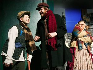 From left, Tiny Tim (Mary Wagner), Bob Cratchit (Seth Shaffer), and Mrs. Bob Cratchit (Kim Yost) perform during a dress rehearsal of Mrs. Bob Cratchit's Wild Christmas Binge.