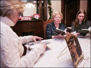 Authors Gaye Gindy, left, and Trini Wenninger examine copies of their book, 'Sylvani