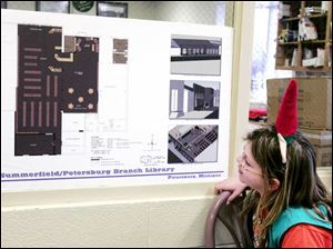 Brianna Breitner takes a look at the future of the Monroe County library branch. The expansion plans were on display during a holiday celebration at the building in Petersburg.